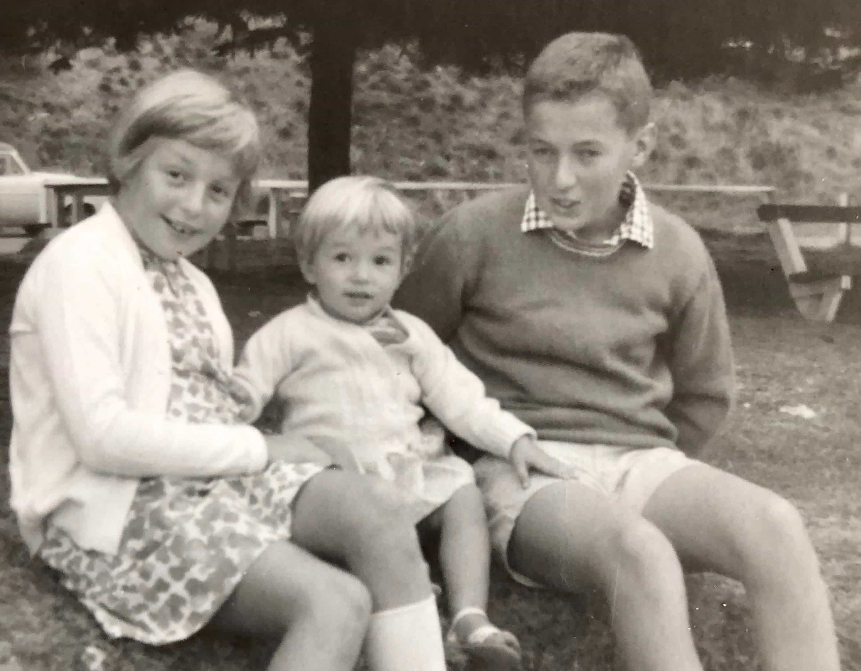 Me in the middle. Sitting with my siblings.